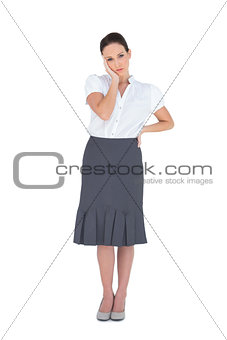 Thinking gorgeous businesswoman posing
