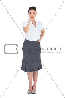 Stylish businesswoman pointing