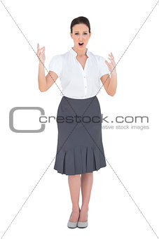Angry stylish businesswoman posing