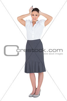 Anxious businesswoman holding her phone