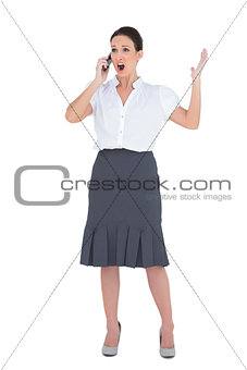 Angry businesswoman having a phone call