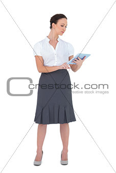 Focused businesswoman using tablet computer