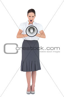 Angry businesswoman shouting in her megaphone