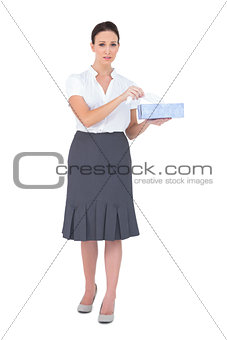 Upset businesswoman holding tissue box