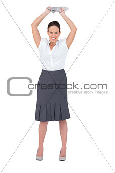 Angry smart businesswoman throwing newspaper away
