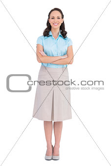 Smiling stylish businesswoman posing