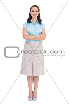 Smiling stylish businesswoman posing