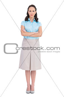 Unsmiling stylish businesswoman posing