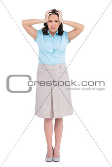 Anxious stylish businesswoman posing