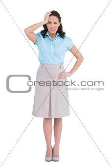 Troubled stylish businesswoman posing
