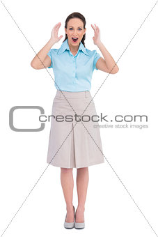 Surprised stylish businesswoman posing