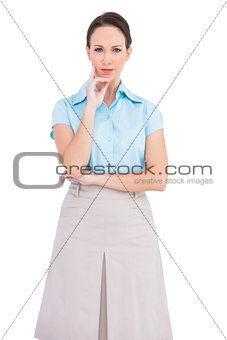 Unsmiling classy businesswoman posing