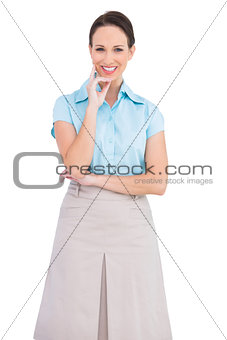Cheerful classy businesswoman posing
