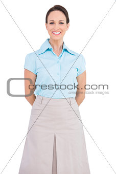 Happy classy young businesswoman posing