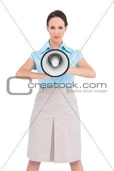 Classy businesswoman holding megaphone