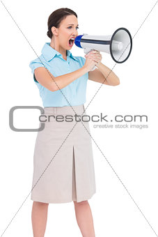 Angry classy businesswoman shouting in her megaphone