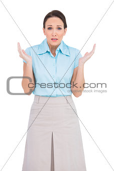 Astonished young businesswoman posing
