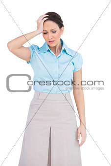 Worried attractive businesswoman posing