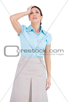 Apprehensive pretty businesswoman posing