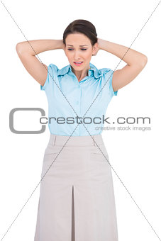 Uneasy young businesswoman posing