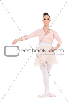 Serious gorgeous ballerina posing for camera