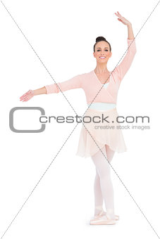 Happy gorgeous ballerina standing in a pose