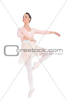 Smiling attractive ballerina spinning
