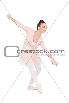 Smiling attractive ballerina dancing