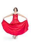 Gorgeous flamenco dancer holding her red dress