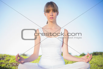 Natural young woman relaxing doing yoga
