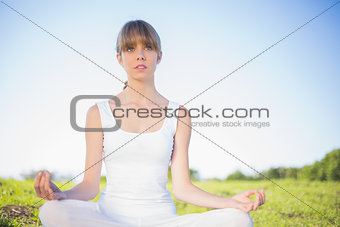 Natural young woman doing yoga