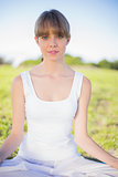 Relaxed natural young woman doing yoga