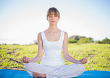 Content natural young woman doing yoga