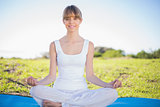 Smiling natural young woman doing yoga