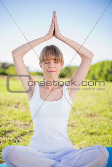 Peaceful young woman relaxing doing yoga