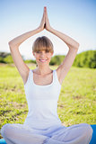 Happy natural young woman doing yoga