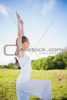 Cheerful young woman stretching outside