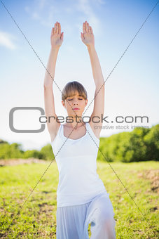 Content young woman stretching outside