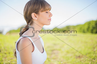 Peaceful young woman relaxing outside