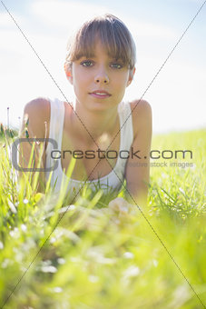 Pretty woman lying on the grass