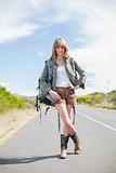 Smiling sexy blonde posing while hitchhiking