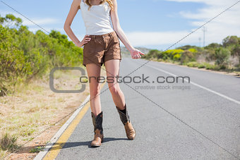 Natural slim woman hitchhiking