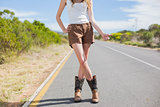 Natural attractive woman posing while hitchhiking