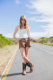 Mysterious attractive woman posing while hitchhiking