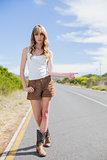 Gorgeous woman posing while hitchhiking