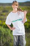 Smiling natural blonde wearing a volunteering t shirt