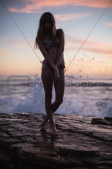 Shadow of attractive woman on sea background