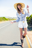 Attractive blonde hitchhiking at the roadside