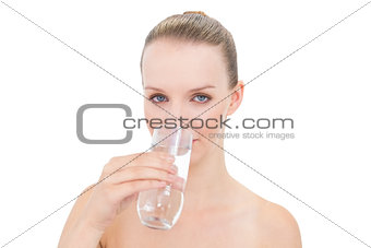 Calm pretty blonde model drinking water