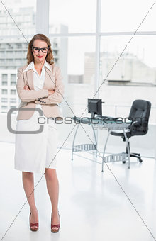 Amused pretty businesswoman looking at camera